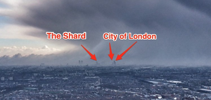 image of snow over the city of london